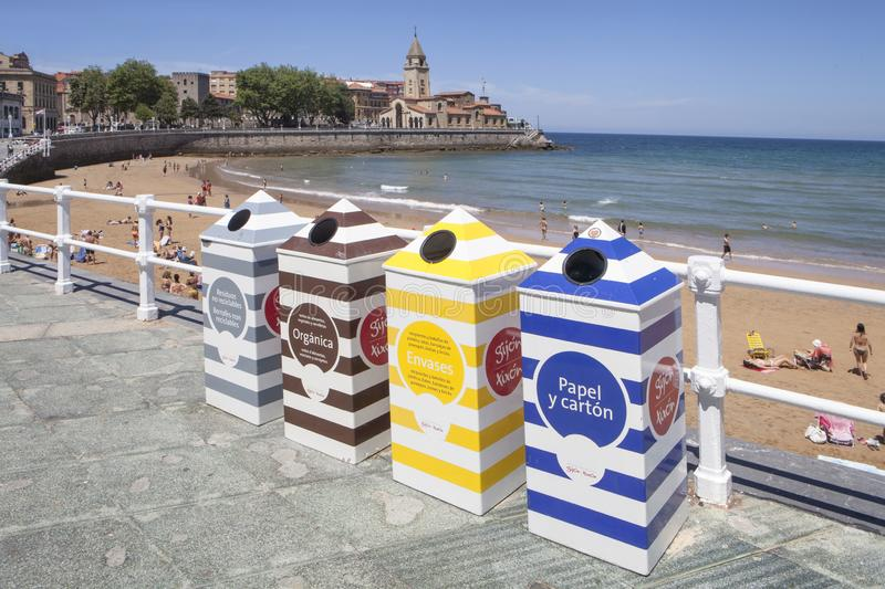 Divided recycling bins with different colors in Gijón. Gijón, Asturias region, Spain, July 10, 2019: Divided recycling bins with different colors in Gij stock photography