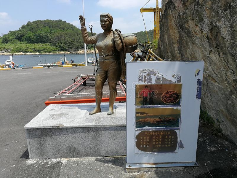Gijang Township, Busan Sea Women Statue. Gijang town famous for fishing industry. Women use to catch fish at the rough sea at this small town stock photography