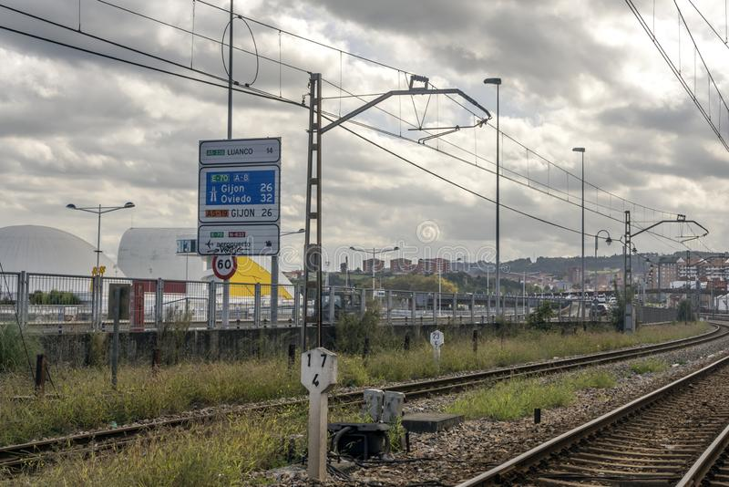 Road near the railway of train. Gijon, Asturias-September 2018. Road near the railway of train station of Gijon in the north of Spain in a cloudy day royalty free stock images