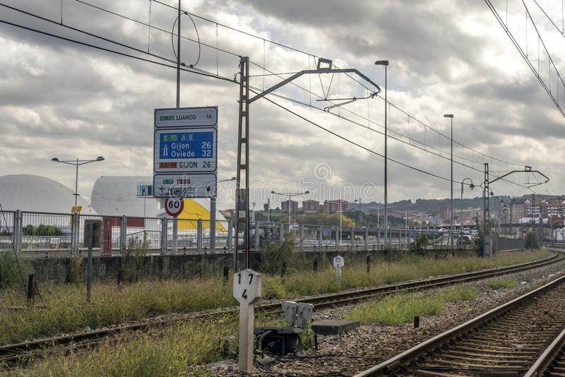 Road near the railway of train. Gijon, Asturias-September 2018. Road near the railway of train station of Gijon in the north of Spain in a cloudy day royalty free stock image