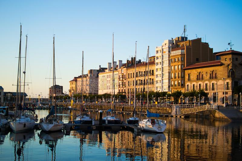 Gijon, Asturias, Spain; 09/26/2018: View of the dock of Gijon, Asturias, Spain, with reflections in the water, in Cimadevilla, the stock images