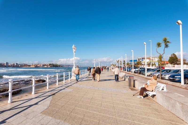 Gijon, Spain - November 19, 2018: Tourist walking in coastal promenade of Gijon city, Asturias, Spain royalty free stock photos