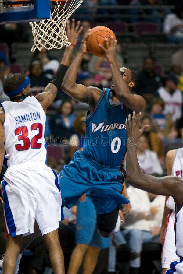 Gilbert Arenas Tries To Score. Gilbert Arenas of the Washington Wizards attempts to score during a game against the Detroit Pistons at the The Palace Of Auburn royalty free stock photography