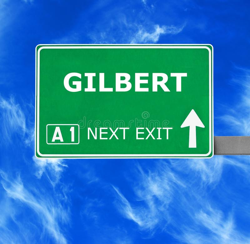 GILBERT road sign against clear blue sky stock photography