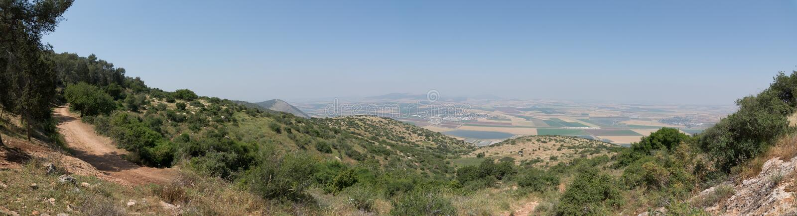 Panoramic view on the valley from mountain ridge royalty free stock image