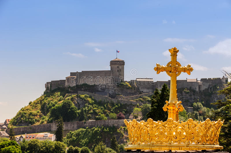 Gilded crown of the Lourdes Basilica stock photo