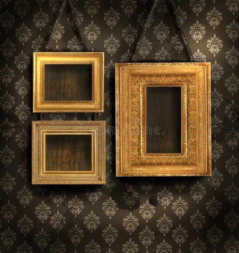 Gilded frames on antique wallpaper. Three gilded frames on antique wallpaper background stock image