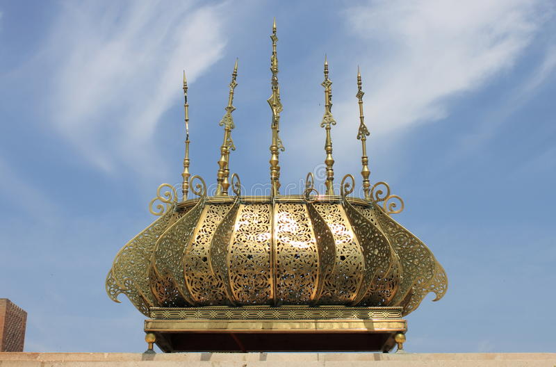 Gilded lamp in the Mausoleum of Rabat. Gilded lamp in the Mausoleum of Mohammed V in Rabat, Morocco stock photography