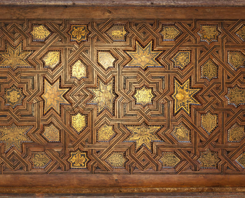 Gilded Ornate Moorish Ceiling. A intricate gilded wooden ceiling from a Moroccan mosque royalty free stock photo