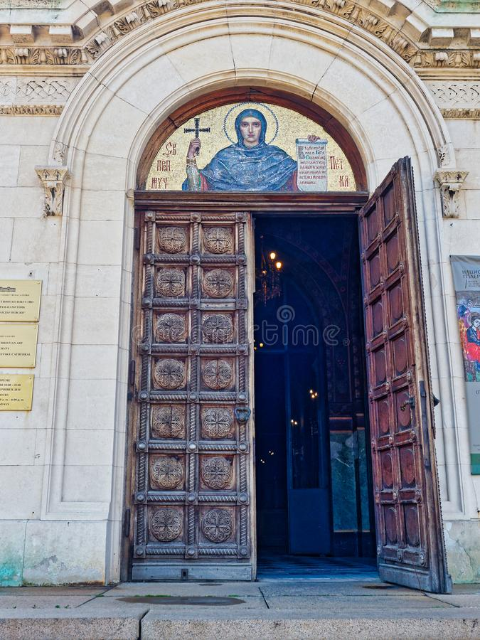 Heavy Wooden Doors, Alexander Nevsky Cathedral, Sofia, Bulgaria. A gilded tile mosaic icon over the heavy wooden carved doors of the Alexander Nevsky Bulgarian stock image
