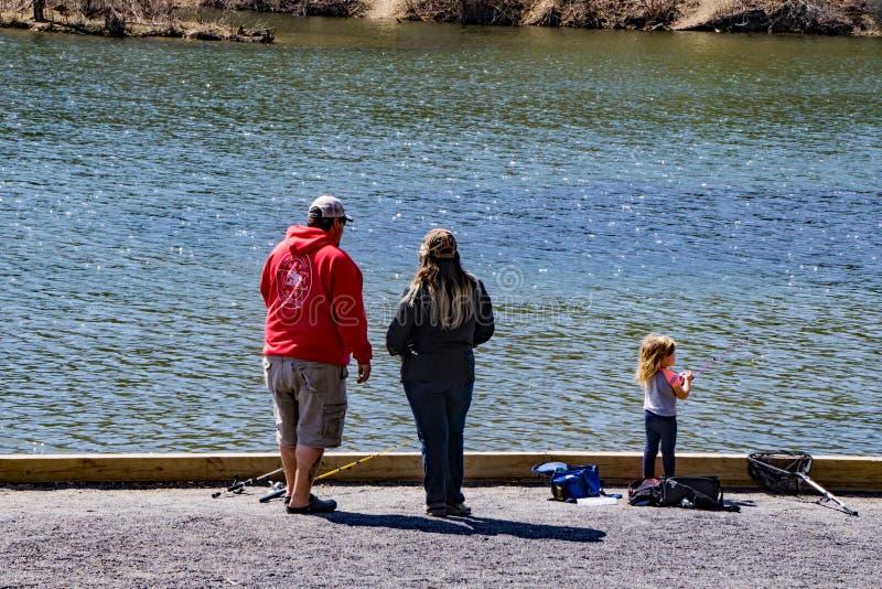 Family of Three Fishing at Pandapas Pond stock photos