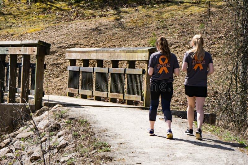 Two Ladies Walking at Pandapas Pond stock image