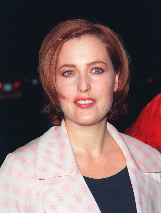 Gillian Anderson. 10DEC98: 'X-Files' star GILLIAN ANDERSON at world premiere of her new movie 'Playing by Heart' in which she stars with Sean Connery. Paul Smith stock image