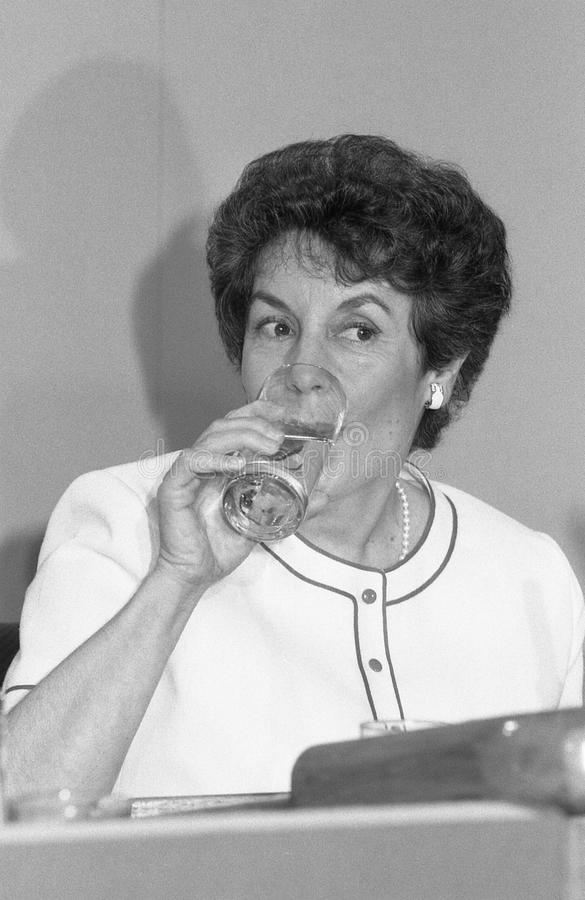 Gillian Shephard. Deputy Chairman of the Conservative party and Member of Parliament for Norfolk South West, drinks a glass of water at a party conference in stock photography