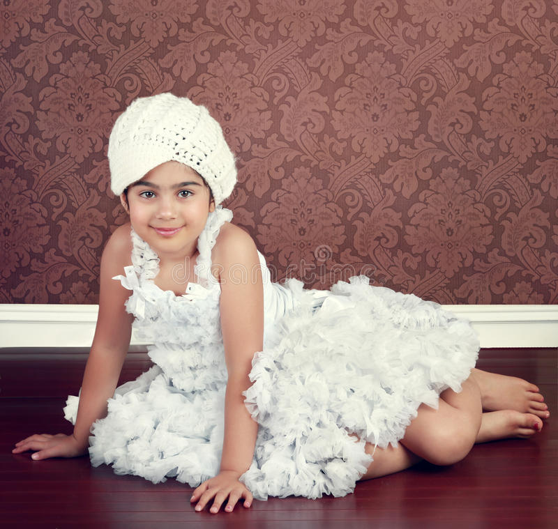Gilr in ruffles. Little girl dressed in white ruffled skirt and top royalty free stock image