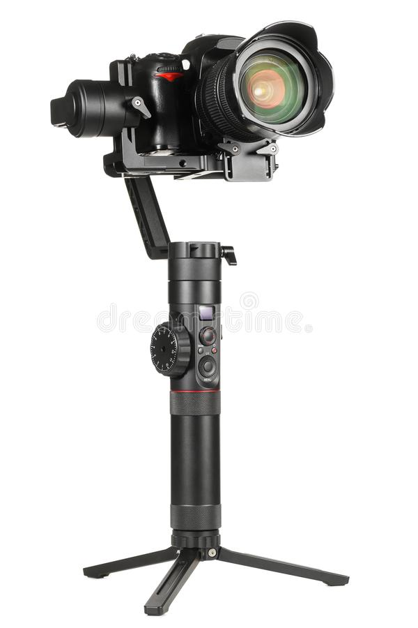 Gimbal stabilizer with camera. Gimbal three-axis motorized stabilizer with mounted DSLR camera isolated on white background royalty free stock photography