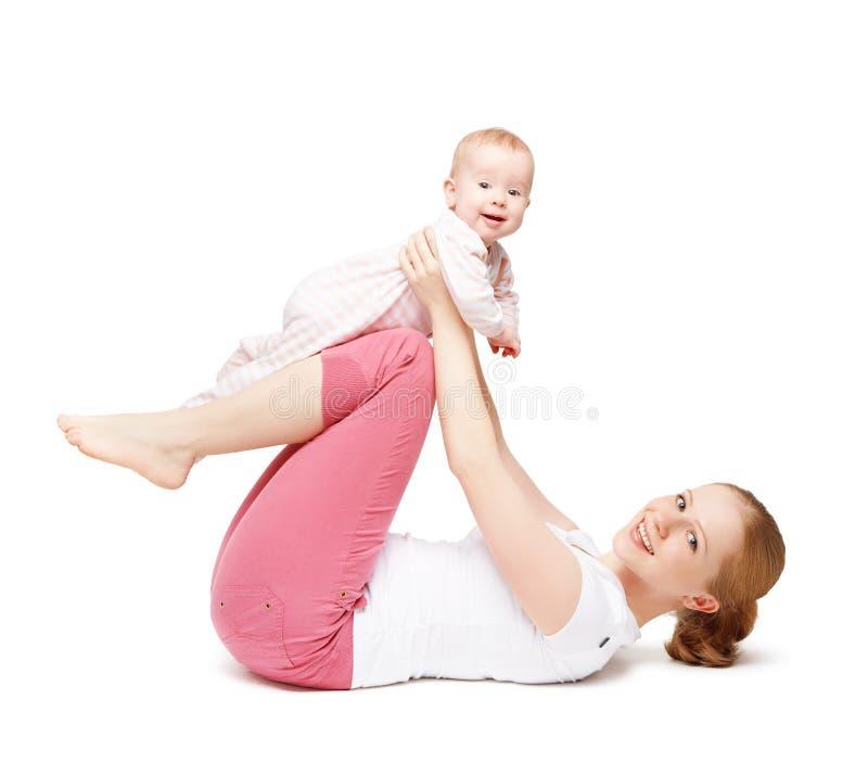 Ginástica da mãe e do bebê, exercícios da ioga isolados imagem de stock