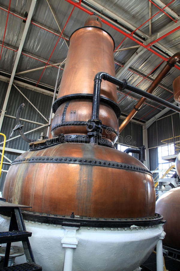 Gin kettle. Old brass gin kettles in a distill. Production of gin through distill process stock photos