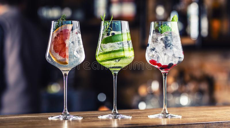 Gin tonic cocktails in wine glasses on bar counter in pup or restaurant royalty free stock photography