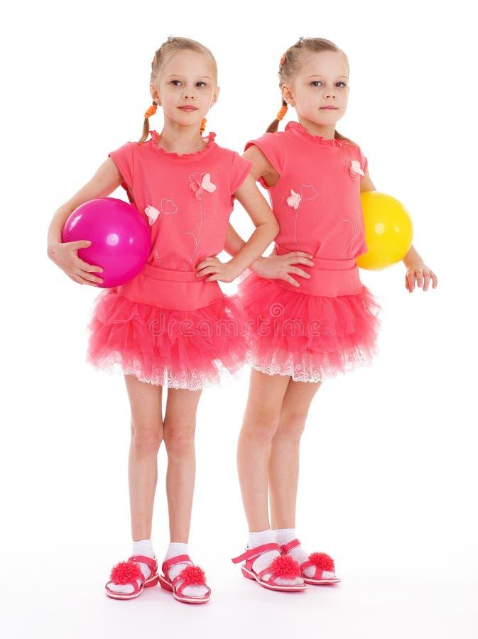 Ginasta de duas moças com bolas dos esportes. imagens de stock royalty free