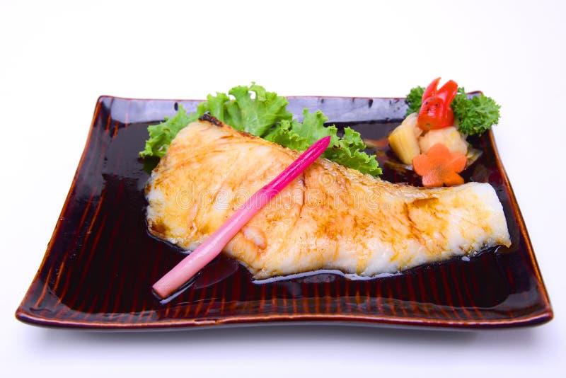 Gindara Teriyaki, peixe de bacalhau grelhado com o molho de soja, isolado sobre fotografia de stock