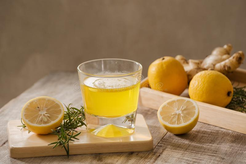 Ginger Ale or Kombucha in Bottle - Homemade lemon and ginger organic probiotic drink, copy space.  royalty free stock image