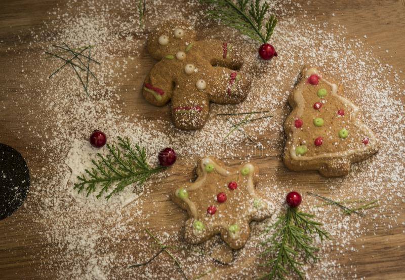 Ginger Bread Christmas Cookies with red, white & green icing stock images