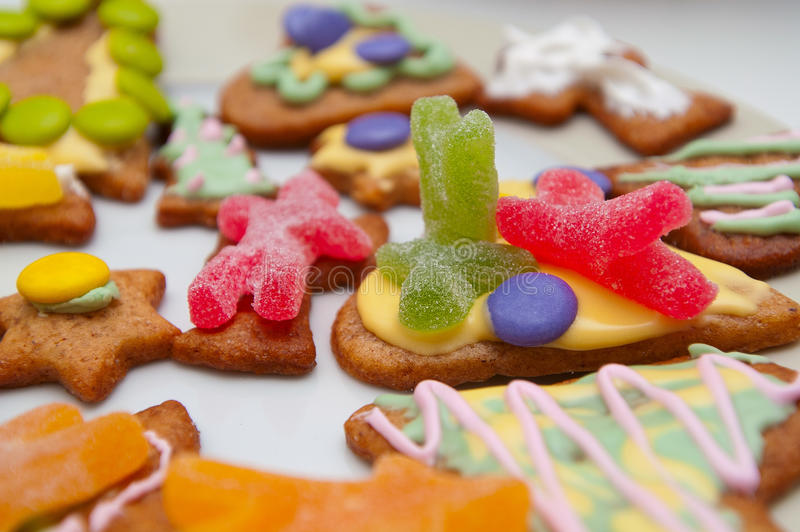 Ginger bread figures with candy topping stock photo
