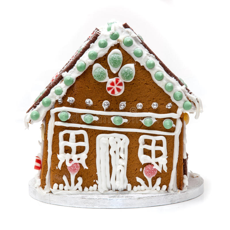Ginger bread house. Traditional home made Ginger bread house isolated on a white studio background royalty free stock images