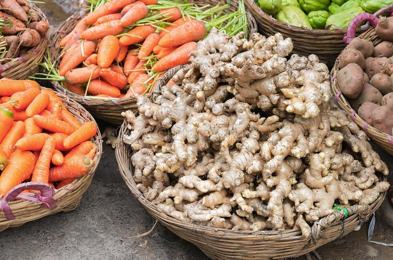 Ginger and carrots at counter street market Can Tho Vietnam. Ginger and carrots at the counter in the street market in Can Tho, in Vietnam royalty free stock photo