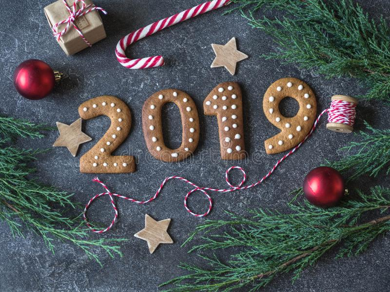 Ginger Christmas or New Year cookies in the form of numbers 2019 on a dark background .Seasonal packaging and New Year`s attribut stock photos