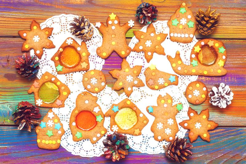 Ginger biscuits and decorative Christmas cones. Festive background. Food and sweets royalty free stock photography