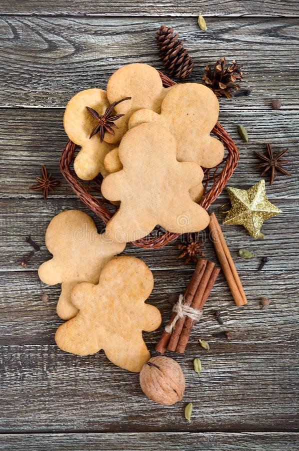Ginger cookies on a wooden table with spices. Gingerbread men. The symbol of Christmas. royalty free stock images