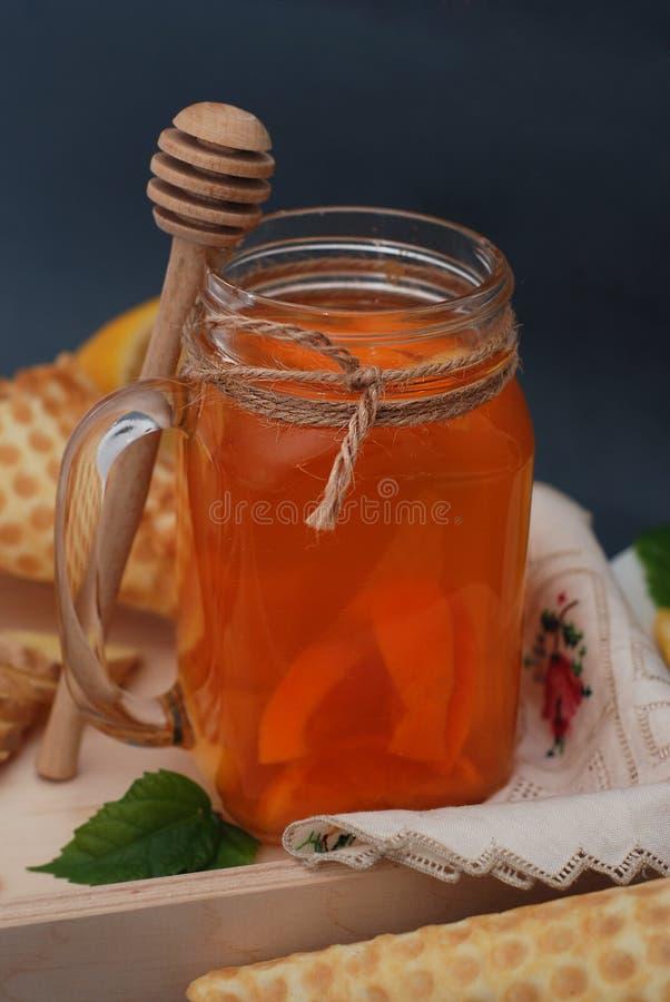 Ginger or Fruit Citrus Tea. tea. Ginger, lemon, mint leaves and Honney. Waffle cones. Selective focus. Dark Background. royalty free stock photo