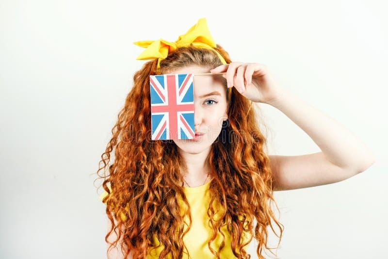 Ginger Girl Showing Flag von England lizenzfreie stockfotos