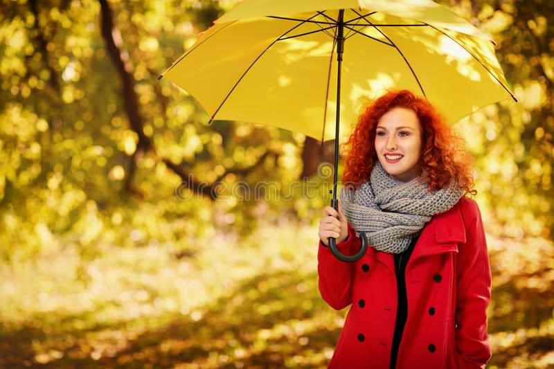 Girl with umbrella in park royalty free stock image