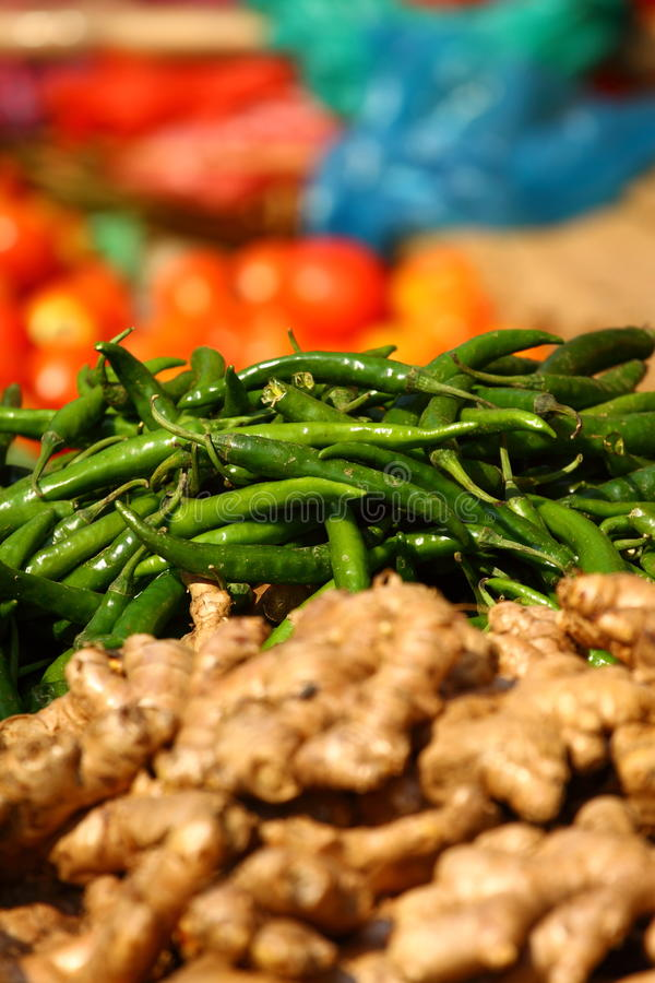 Ginger and green paprica in traditional market. royalty free stock images
