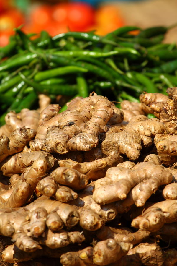 Ginger and green paprica in traditional market. stock images
