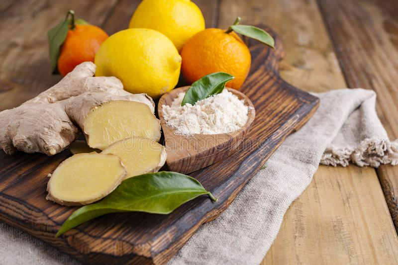 Ginger and lemon on a wooden background, Photo in a rustic style. Ingredients for warming and health drink. Alternative medicine. Free space for text stock photos