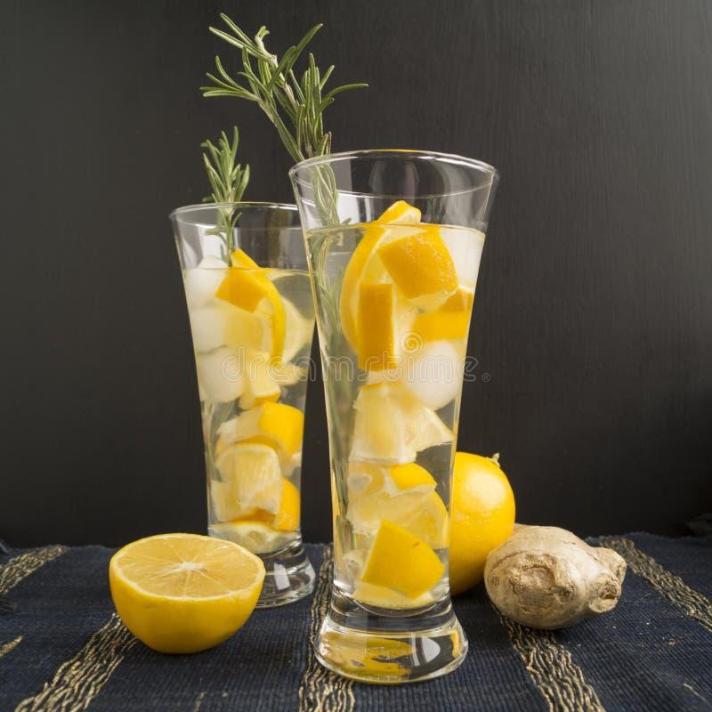 Ginger lemonade. And ingredients - ginger, lemon, black background stock images