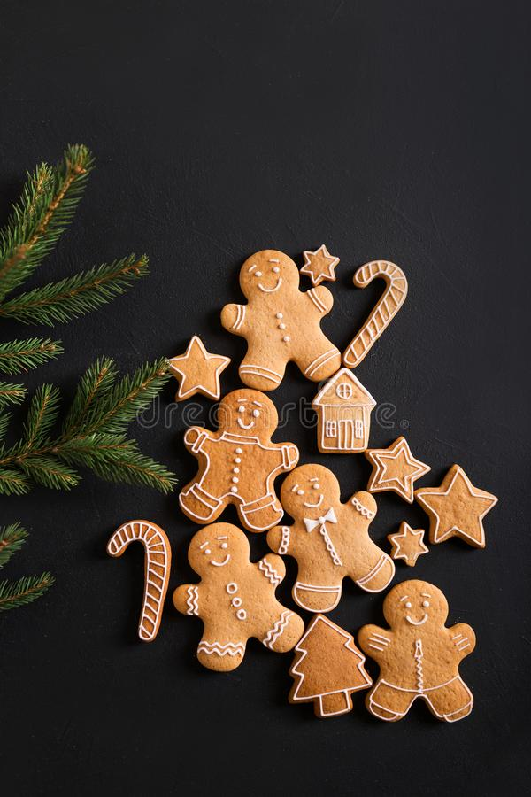 Ginger men with glaze on a black background . Gingerbread. Christmas cookies stock photography