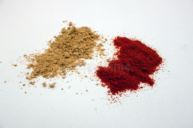 Ginger and paprika powder. On a white background royalty free stock photography