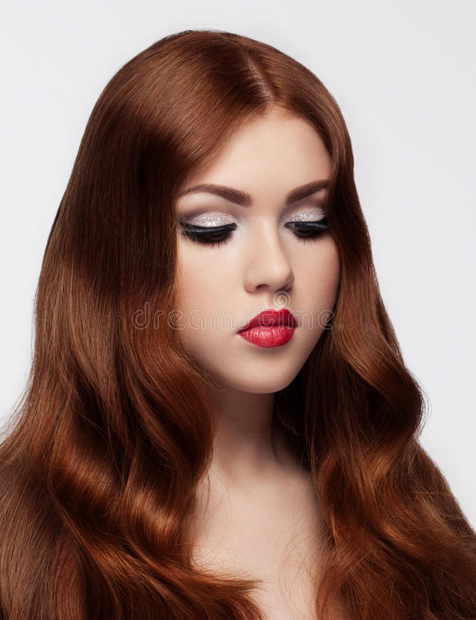 Ginger red long hair.Fashion portrait red lips. On white background royalty free stock image
