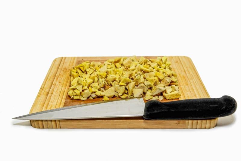 Ginger Root coupé avec le bloc et le couteau de coupe image libre de droits