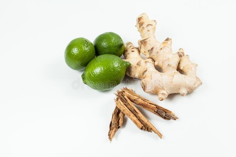 Ginger root with lemon and cinnamon photo on neutral background.  stock images