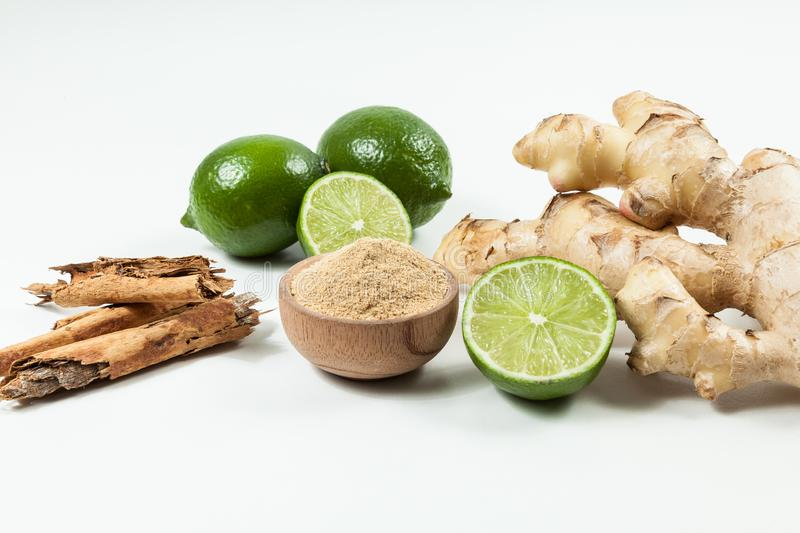Ginger root with lemon and cinnamon photo on neutral background.  royalty free stock photos