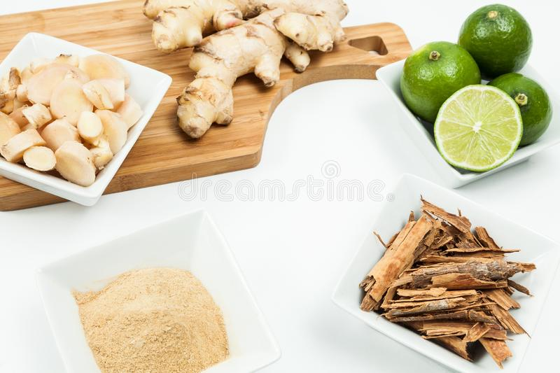 Ginger root with lemon and cinnamon photo on neutral background.  royalty free stock photography
