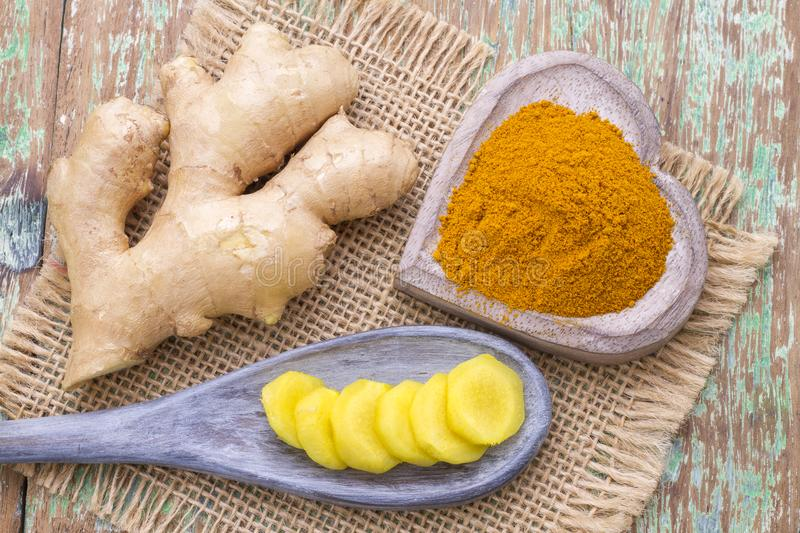 Ginger roots and turmeric on the table stock photos