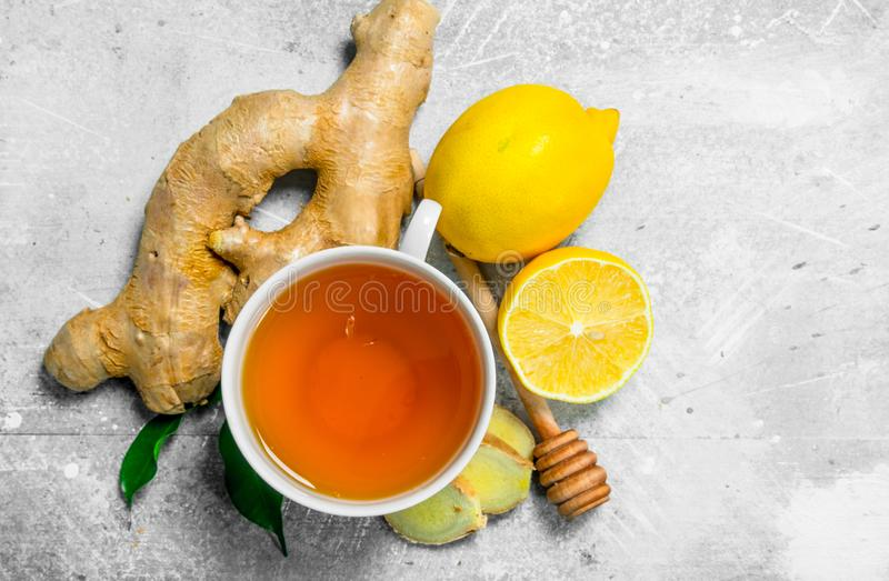 Ginger tea in cup and lemon stock image