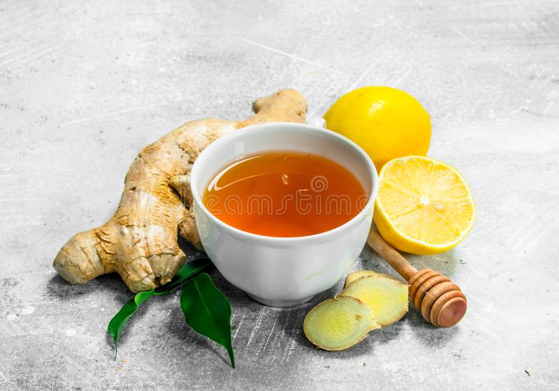 Ginger tea in cup and lemon stock photography